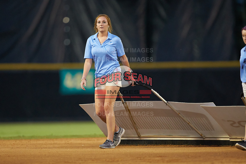 A member of the Burlington Royals game day staff drags the infield between innings of the game against the Danville Braves at Burlington Athletic Stadium on August 9, 2019 in Burlington, North Carolina. The Royals defeated the Braves 6-0. (Brian Westerholt/Four Seam Images)