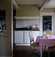 In the kitchen of an 18th century Dutch house tones of green earth and grey create a haven of tranquillity