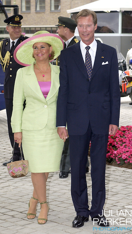 Grand Duke Henri & Grand Duchess Maria-Theresa attend the Christening of Crown Prince Willem-Alexander & Crown Princess Maxima of Holland's daughter Catharina-Amalia at the St. Jacobskerk Church in The Hague..