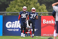 July 26, 2018: New England Patriots defensive back Jordan Richards (37) and defensive lineman Geneo Grissom (96) stretch before practice at the New England Patriots training camp held on the practice fields at Gillette Stadium, in Foxborough, Massachusetts. Eric Canha/CSM