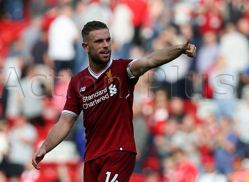 27th August 2017, Anfield, Liverpool, England; EPL Premier League football, Liverpool versus Arsenal; Jordan Henderson of Liverpool raises his thumb to the fans on the Kop as they applaud after the final whistle