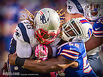 12 October 2014: New England Patriots running back Brandon Bolden (38) is tackled by Buffalo Bills outside linebacker Keith Rivers (56) at Ralph Wilson Stadium in Orchard Park, NY. The Patriots defeated the Bills 37-22 to move into first place in the AFC Eastern Division. Mandatory Credit: Ed Wolfstein Photo Original image was made as a RAW (NEF) file using a Nikon D4 DSLR camera.