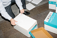 Campaign workers box up blank paper used as the US Tax Code for a stage prop after Kentucky senator and Republican presidential candidate Rand Paul spoke at a town hall campaign event at Kilton Library in West Lebanon, New Hampshire.
