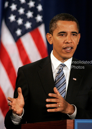 """Chicago, IL - December 11, 2008 -- United States President-elect  Barack Obama gestures as he speaks at a news conference Thursday December 11, 2008, in Chicago, Illinois. In his remarks, Obama said he was """"appalled and disappointed"""" by the revelations this week concerning Illinois Governor Rod Blagojevich's alleged attempts to sell Obama's old United States Senate seat..Credit: Frank Polich - Pool via CNP"""