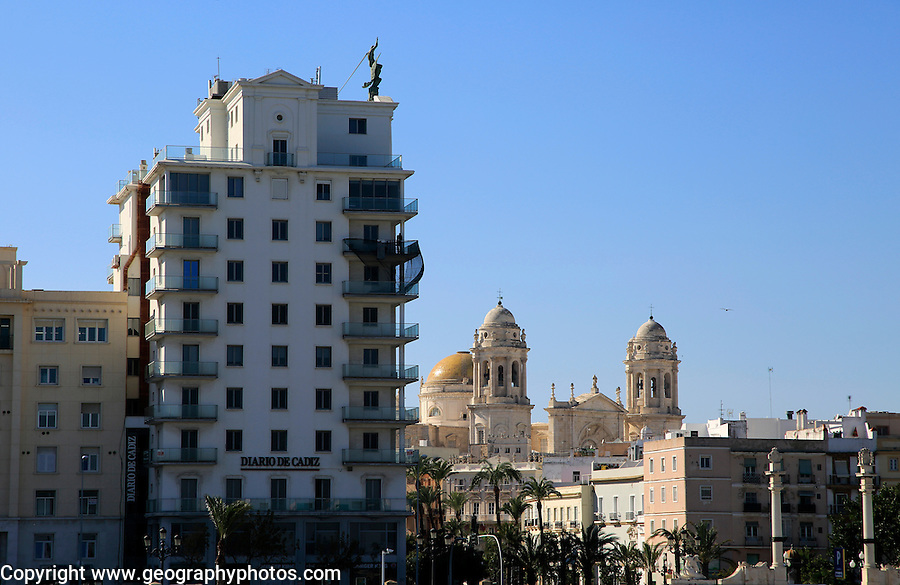 City centre buildings and cathedral church building, Cadiz, Spain seen from the sea