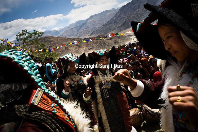"Local Laddhaki dancers gather outside the Hemis Monastery to perform for His Holiness the Twelfth Gyalwang Drukpa, the head of the Drukpa Lineage. His Holiness finished his, ""Walking On The World's Rooftop"" Pad Yatra (walk) from Manali to Ladakh. The 400 kms walk was focused at raising awareness awareness of His Holiness' charitable projects including education, environment and cultural preservation of tribal people from the area. The culmination of the Pad Yatra coincides with the colourful age-old Hemis festival in Leh, Ladakh, India."