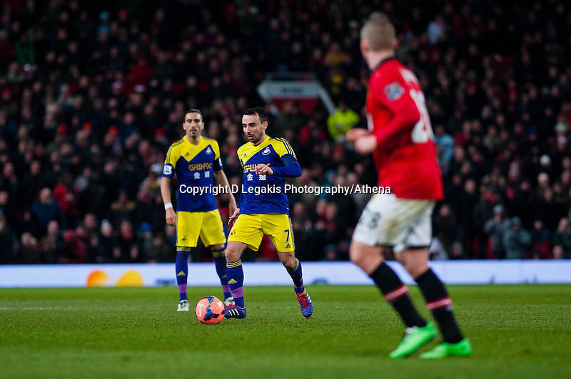 Sunday 05 January 2014<br /> Pictured: Leon Britton takes the ball forward<br /> Re: Manchester Utd FC v Swansea City FA cup third round match at Old Trafford, Manchester