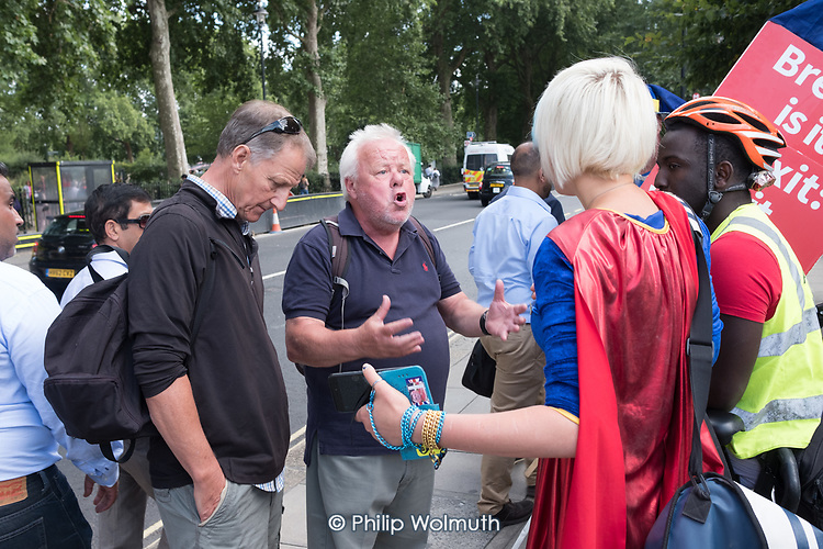 A Brexiter argues with Remainers outside the Houses of Parliament, Westminster, London.