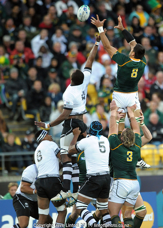 Springbok number eight Pierre Spies wins lineout ball during the South Africa versus Fiji pool D match of the 2011 IRB Rugby World Cup at Wellington Regional Stadium, Wellington, New Zealand on Saturday, 17 September 2011. Photo: Dave Lintott / lintottphoto.co.nz