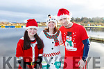 The Reidy family from Ballyduff, Tara, Geraldine and Micheal Reidy ready to run for fun at the Santa Fun run in memory of Fiona Moore, in the Tralee Bay Wetlands on Sunday.