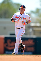Baltimore Orioles outfielder Nate McLouth #9 runs the bases after hitting a home run during a Spring Training game against the New York Mets at Ed Smith Stadium on March 30, 2013 in Sarasota, Florida.  (Mike Janes/Four Seam Images)