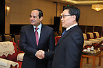 A handout picture released by Egyptian Presidency shows Egyptian President Abdel Fattah El-Sisi meeting with Sichuan governor during his visit Sichuan city, China, December 25, 2014. President Abdel Fattah El Sisi has concluded his visit of China after touring the key industrial city of Sichuan, Sisi urged Chinese companies in Sichuan to seek investment opportunities in Egypt and called for promoting tourism from the city to Egypt. Photo by Egyptian Presidency. Photo by Egyptian Presidency