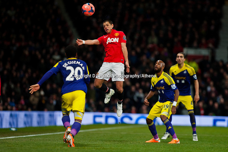 Sunday 05 January 2014<br /> Pictured: Javier Hernandez  jumps for the ball <br /> Re: Manchester Utd FC v Swansea City FA cup third round match at Old Trafford, Manchester
