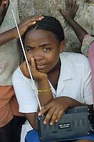 BURUNDI Bujumbura, woman listen to the radio / BURUNDI Bujumbura, Frau hoert Radio