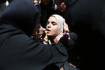 Palestinian relatives mourn during the funeral of Ziad al-Barim, 25, who was shot dead by Israeli troops during clashes at Israel-Gaza border, in Khan Younis in the southern Gaza strip on June 9, 2018. Four Palestinians were killed by Israeli fire on the Gaza border on June 8, the territory's health ministry said giving a new toll, as weeks of deadly clashes with protesters continued. Photo by Ashraf Amra