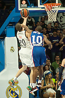 Real Madrid´s Jaycee Carroll and Anadolu Efes´s Dontaye Draper during 2014-15 Euroleague Basketball match between Real Madrid and Anadolu Efes at Palacio de los Deportes stadium in Madrid, Spain. December 18, 2014. (ALTERPHOTOS/Luis Fernandez) /NortePhoto /NortePhoto.com