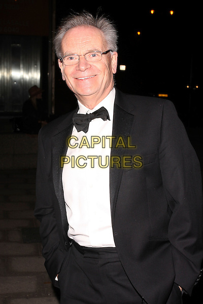 LORD JEFFREY ARCHER.At the Evening Standard Influentials Party, Altitude 360, Millbank Tower, London, England, UK, .16th November 2010..half length black tuxedo tux bow tie suit glasses hands in pockets smiling .CAP/AH.©Adam Houghton/Capital Pictures.