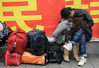Migrant workers waiting to leave the train station in Nanchang, Jiangxi province in China..05 Feb 2009