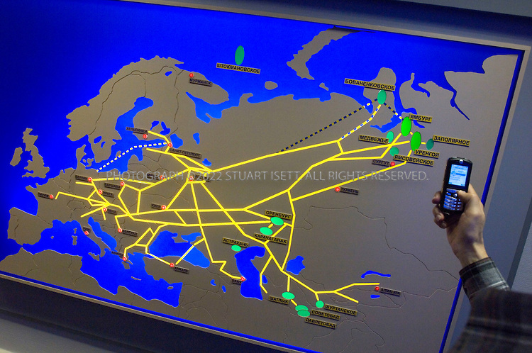 5/25/2006--Novy Urengoy, Yamal-Nenets Autonomous region, Siberia, Russia..At a Gasprom museum, a guide points to a map showing oil and gas pipelines from Russia to Europe. The city of Novy Urengoy is the centre of the Western Siberian gas industry and home to the head office of the most significant gas production company within the Gazprom Group. Novy Urengoy is a young city 80 km from the polar circle with approx. 100,000 inhabitants. The region's wealth is deep in the ground - natural gas...Photograph By Stuart Isett.All photographs ©2006 Stuart Isett.All rights reserved.