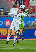25 April 2010:   Toronto FC defender Raivis Hscanovics #34 and Seattle Sounders midfielder Sanna Nyassi #23 in action during a game between the Seattle Sounders and Toronto FC at BMO Field in Toronto..Toronto FC won 2-0....