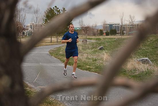 Trent Nelson  |  The Salt Lake Tribune.Scott Kunz of South Jordan, Utah is running his 100th marathon, in Salt Lake City, this weekend. Kunz was photographed on the Jordan River Parkway Wednesday, April 13, 2011.