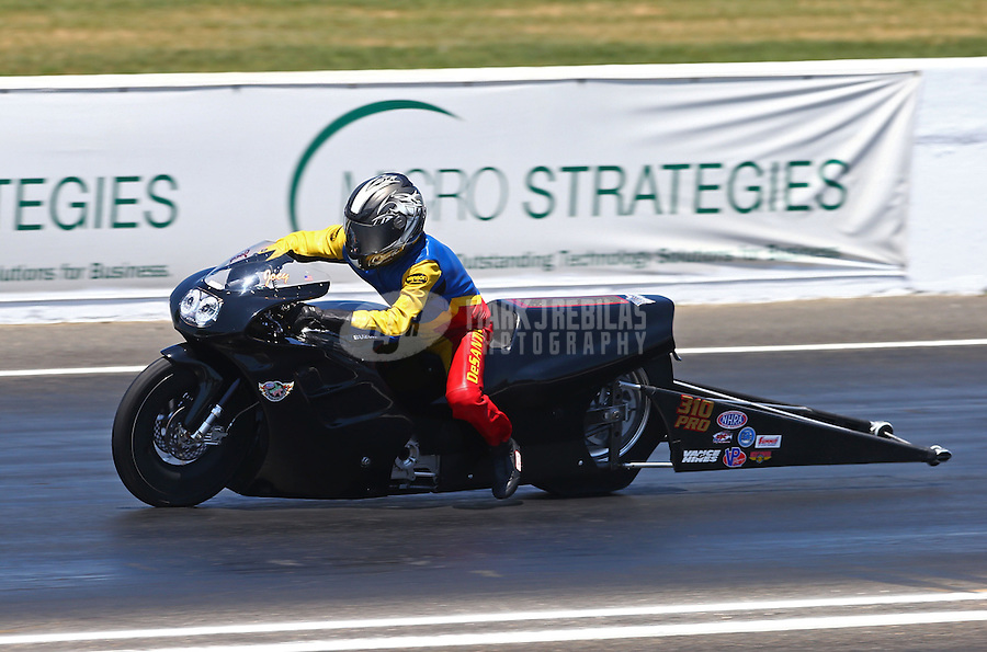 Jun. 1, 2013; Englishtown, NJ, USA: NHRA pro stock motorcycle rider Joe DeSantis during qualifying for the Summer Nationals at Raceway Park. Mandatory Credit: Mark J. Rebilas-