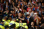 Police try to restrain the Ajax fans