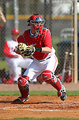Catcher Greg Solomon #16 of the Ohio State Buckeyes during a game vs the St. John's Red Storm at the Big East-Big Ten Challenge at Walter Fuller Complex in St. Petersburg, Florida;  February 20, 2011.  Ohio State defeated St. John's 8-7 in 11 innings.  Photo By Mike Janes/Four Seam Images