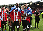 Sheffield United's Ethan Ebanks-Landell and Leon Clarke celebrate during the League One match at Bramall Lane, Sheffield. Picture date: April 30th, 2017. Pic David Klein/Sportimage