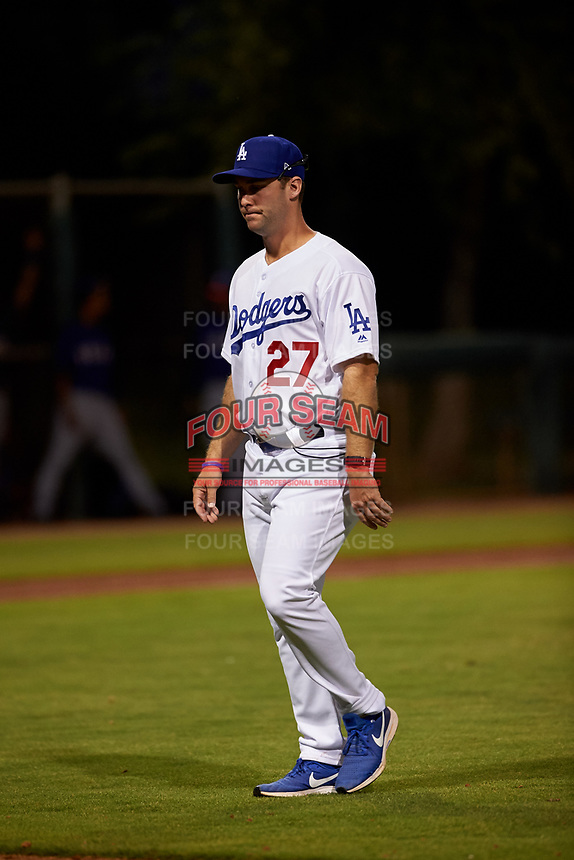 AZL Dodgers Mota pitching coach Stephanos Stroop (27) walks off the field after a conversation with his pitcher during an Arizona League game against the AZL Rangers at Camelback Ranch on June 18, 2019 in Glendale, Arizona. AZL Dodgers Mota defeated AZL Rangers 13-4. (Zachary Lucy/Four Seam Images)