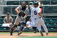 5 June 2010:  FIU's Sean Reilly (24) adjusts for the throw home in the third inning as the Dartmouth Green Wave defeated the FIU Golden Panthers, 15-9, in Game 3 of the 2010 NCAA Coral Gables Regional at Alex Rodriguez Park in Coral Gables, Florida.