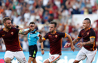 Calcio, Serie A: Roma vs Juventus. Roma, stadio Olimpico, 30 agosto 2015.<br /> Roma&rsquo;s Miralem Pjanic, center, celebrates with teammates Daniele De Rossi, left, and Radja Nainggolan, after scoring during the Italian Serie A football match between Roma and Juventus at Rome's Olympic stadium, 30 August 2015.<br /> UPDATE IMAGES PRESS/Riccardo De Luca