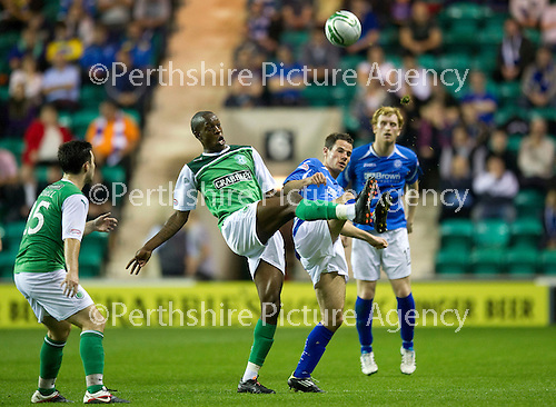Hibs v St Johnstone...28.09.11   SPL Week.Kevin Moon and Isaiah Osbourne.Picture by Graeme Hart..Copyright Perthshire Picture Agency.Tel: 01738 623350  Mobile: 07990 594431