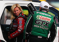 Apr 26, 2014; Baytown, TX, USA; NHRA funny car driver Courtney Force (left) talks with father John Force during qualifying for the Spring Nationals at Royal Purple Raceway. Mandatory Credit: Mark J. Rebilas-USA TODAY Sports