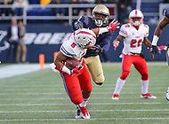 Annapolis, MD - November 11, 2017: Southern Methodist Mustangs running back Xavier Jones (5) gets facemasked by Navy Midshipmen safety Jarid Ryan (2) during the game between SMU and Navy at  Navy-Marine Corps Memorial Stadium in Annapolis, MD.   (Photo by Elliott Brown/Media Images International)
