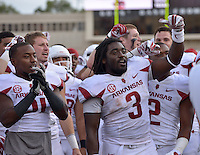 STAFF PHOTO BEN GOFF  @NWABenGoff -- 09/13/14 Arkansas running back Alex Collins (3) and other players celebrate after defeating Texas Tech in Jones AT&T Stadium in Lubbock, Texas on Saturday September 13, 2014.