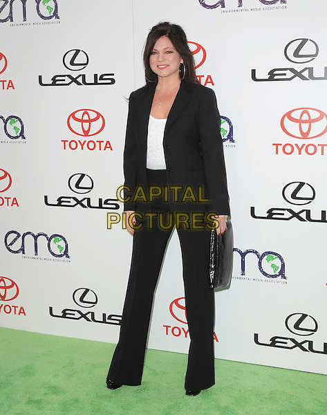 Valerie Bertinelli.attends The 21st Annual Environmental Media Awards held at at Warner Bros. Studios in Burbank, California, USA, October 15th 2011..full length black suit jacket white top trousers wide leg clutch bag .CAP/RKE/DVS.©DVS/RockinExposures/Capital Pictures.