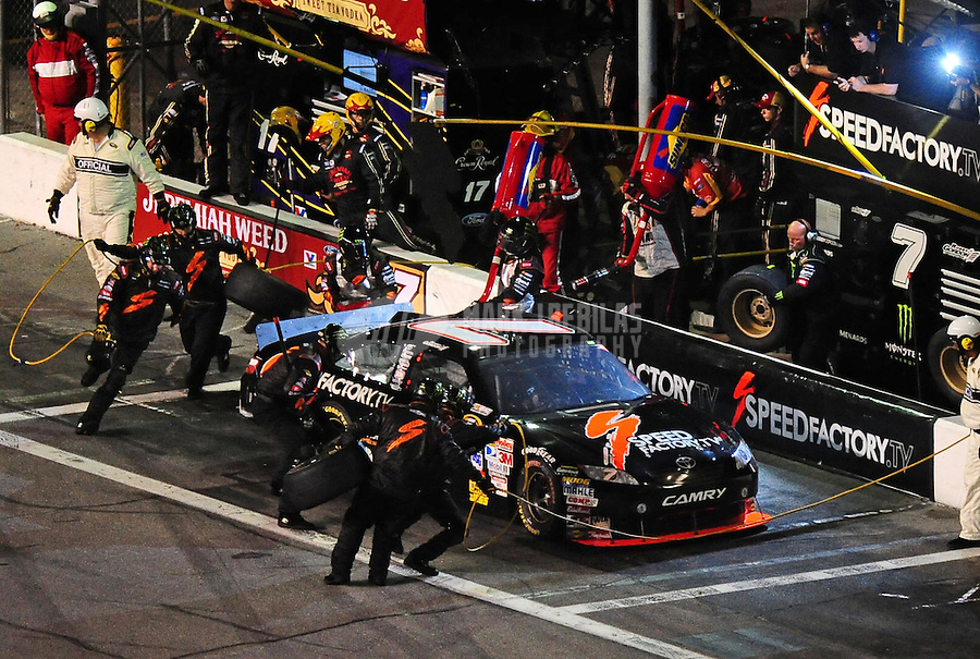 Jul. 3, 2010; Daytona Beach, FL, USA; NASCAR Sprint Cup Series driver Robby Gordon (7) pits during the Coke Zero 400 at Daytona International Speedway. Mandatory Credit: Mark J. Rebilas-