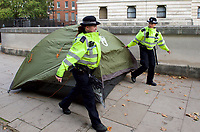 Police remove the tents of Extinction Rebellion protesters in London on 09 October 2019 in London, England.<br /> .<br /> Protesters plan to blockade the London government district for a two week period, as part of 'International Rebellion' taking place in over 60 cities around the world, calling for decisive and immediate action from governments in the face of climate and ecological emergency. <br /> .<br />  Photo by Alan  Stanford.