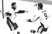Kris Letang #58 and Pascal Dupuis #9 of the Pittsburgh Penguins celebrate their 3-1 win against the San Jose Sharks during game six of the Stanley Cup Final at SAP Center in San Jose, California on June 12, 2016. (Photo by Jared Wickerham / DKPS)