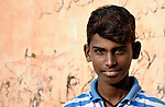 A  boy who works as a scavenger in the municipal garbage dump in Chennai, India. He and other boys are hosted in a night shelter run by the Madras Christian Council of Social Service.