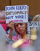 """A protestor holds up a sign in protest during the United States Senate Foreign Relations Committee hearing on """"Authorization of Use of Force in Syria""""  on Capitol Hill in Washington, D.C. on Tuesday, September 3, 2013.<br /> Credit: Ron Sachs / CNP"""