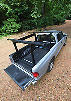 NWA Democrat-Gazette/FLIP PUTTHOFF <br />It's easy to build a wooden canoe and kayak rack    June 25 2018   that slides into a pickup bed. It takes about one minute to install or remove the rack from a truck bed and light enough for one person to carry.