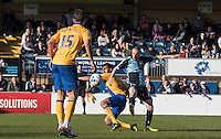 Michael Harriman of Wycombe Wanderers beats Malvind Benning of Mansfield Town with a shot at goal during the Sky Bet League 2 match between Wycombe Wanderers and Mansfield Town at Adams Park, High Wycombe, England on 25 March 2016. Photo by Kevin Prescod.