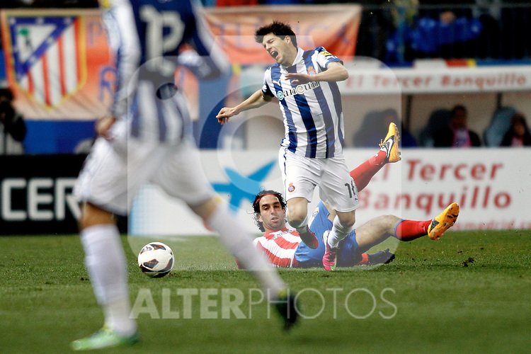 Atletico de Madrid's Arda Turan and Espanyol's J.Lopez during La Liga  match. February 24,2013.(ALTERPHOTOS/Alconada)