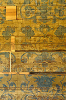A fragment of a floral interlaced design which was painted on the wooden walls