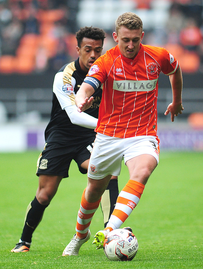 Blackpool's David Ferguson under pressure from Swindon Town's Nicky Ajose<br /> <br /> Photographer Kevin Barnes/CameraSport<br /> <br /> Football - The Football League Sky Bet League One - Blackpool v Swindon Town - Saturday 3rd October 2015 - Bloomfield Road - Blackpool<br /> <br /> &copy; CameraSport - 43 Linden Ave. Countesthorpe. Leicester. England. LE8 5PG - Tel: +44 (0) 116 277 4147 - admin@camerasport.com - www.camerasport.com