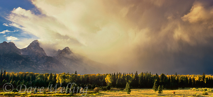 937000027 panorama view of the sun filtering through a magnificent cloud bank hovering above the teton range as viewed from blacktail ponds overlook in grand tetons national park wyoming