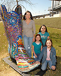 From left: Art Instructor Tracy Reed, Rachel Reed, Elliett Reed and Emma Reed by their decorated boot outside Reliant Stadium Saturday March 3,2007.(Dave Rossman/For the Chronicle)