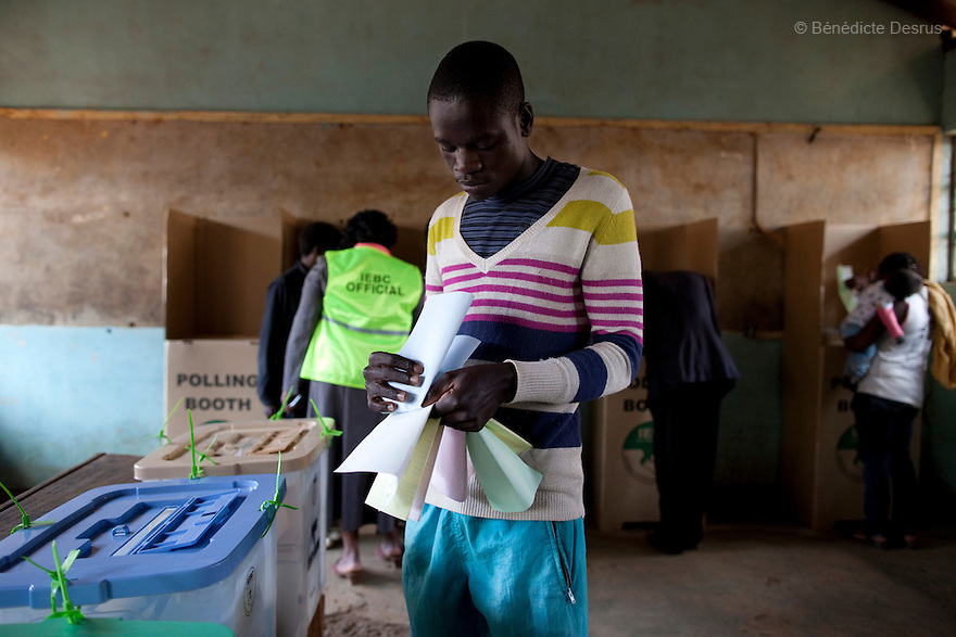 4 March 2013 - Nairobi, Kenya - A man casts his vote at a polling centre during the Kenyan general elections in Nairobi, Kenya. Five years after more than 1,000 people were killed in election-related violence, Kenyans began casting votes in a nationwide election seen as the country's most important, and complicated, in its 50-year history. Uhuru Kenyatta, one of two top candidates for president, faces charges at the International Criminal Court for orchestrating the 2007-08 postelection violence. Photo credit: Benedicte Desrus